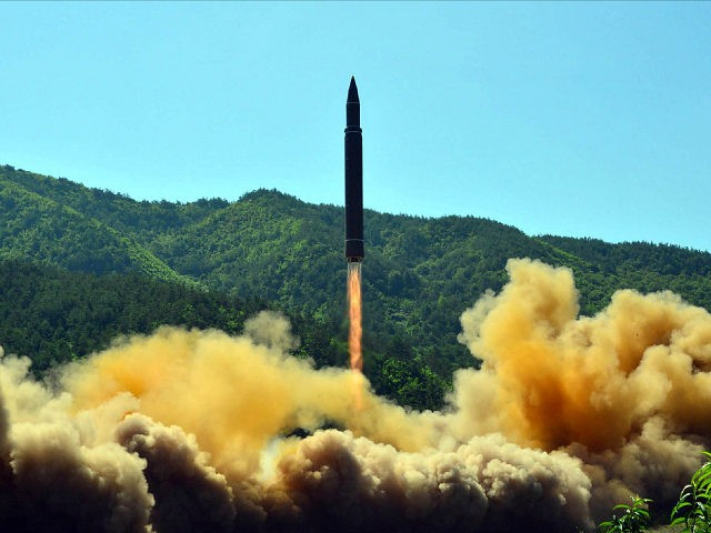 TOPSHOT - This picture taken on July 4, 2017 and released by North Korea's official Korean Central News Agency (KCNA) on July 5, 2017 shows the successful test-fire of the intercontinental ballistic missile Hwasong-14 at an undisclosed location. South Korea and the United States fired off missiles on July 5 simulating a precision strike against North Korea's leadership, in response to a landmark ICBM test described by Kim Jong-Un as a gift to 'American bastards'. / AFP PHOTO / KCNA VIA KNS / STR / South Korea OUT / REPUBLIC OF KOREA OUT ---EDITORS NOTE--- RESTRICTED TO EDITORIAL USE - MANDATORY CREDIT 'AFP PHOTO/KCNA VIA KNS' - NO MARKETING NO ADVERTISING CAMPAIGNS - DISTRIBUTED AS A SERVICE TO CLIENTS THIS PICTURE WAS MADE AVAILABLE BY A THIRD PARTY. AFP CAN NOT INDEPENDENTLY VERIFY THE AUTHENTICITY, LOCATION, DATE AND CONTENT OF THIS IMAGE. THIS PHOTO IS DISTRIBUTED EXACTLY AS RECEIVED BY AFP. / (Photo credit should read STR/AFP/Getty Images)