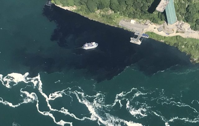 Black discharge from the Niagara Falls Waste Water Treatment Plant engulfs the Maid of the Mist docks. How the Niagara River looked at 4:18 p.m. Saturday. (Courtesy of Rainbow Air Inc.)