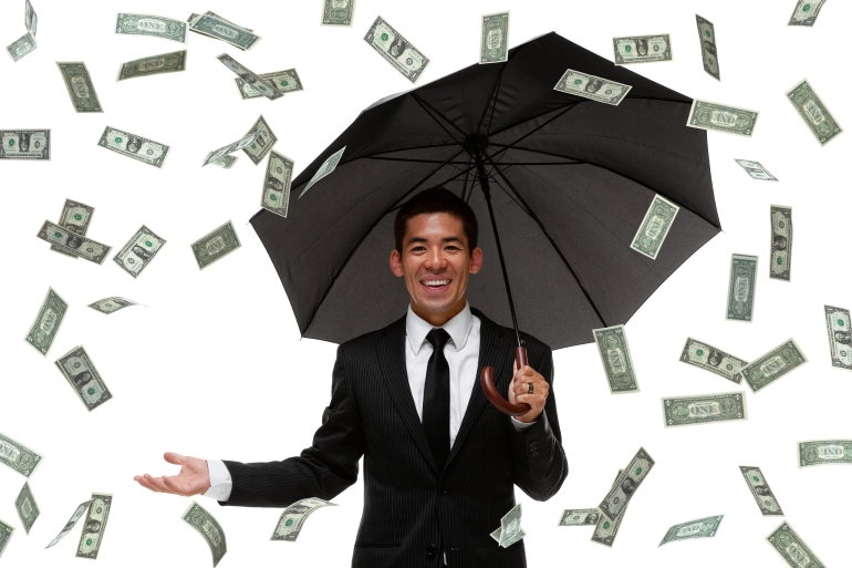 Raining money on a businessman